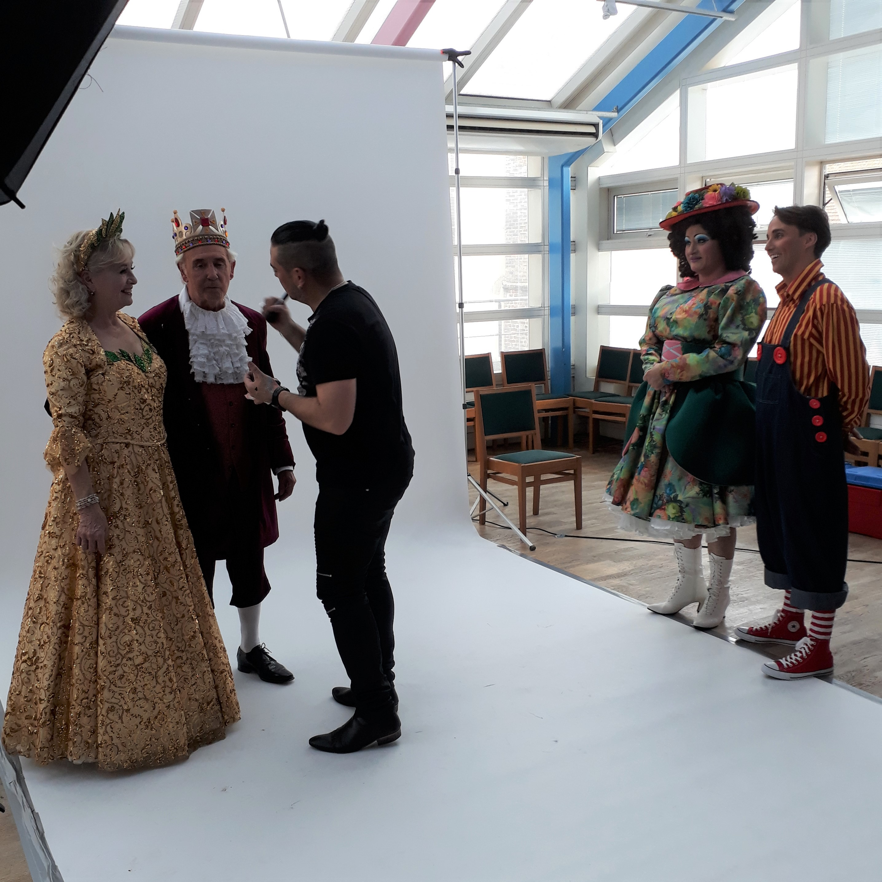 The King and Good Fairy having their make-up done at a photo-shoot