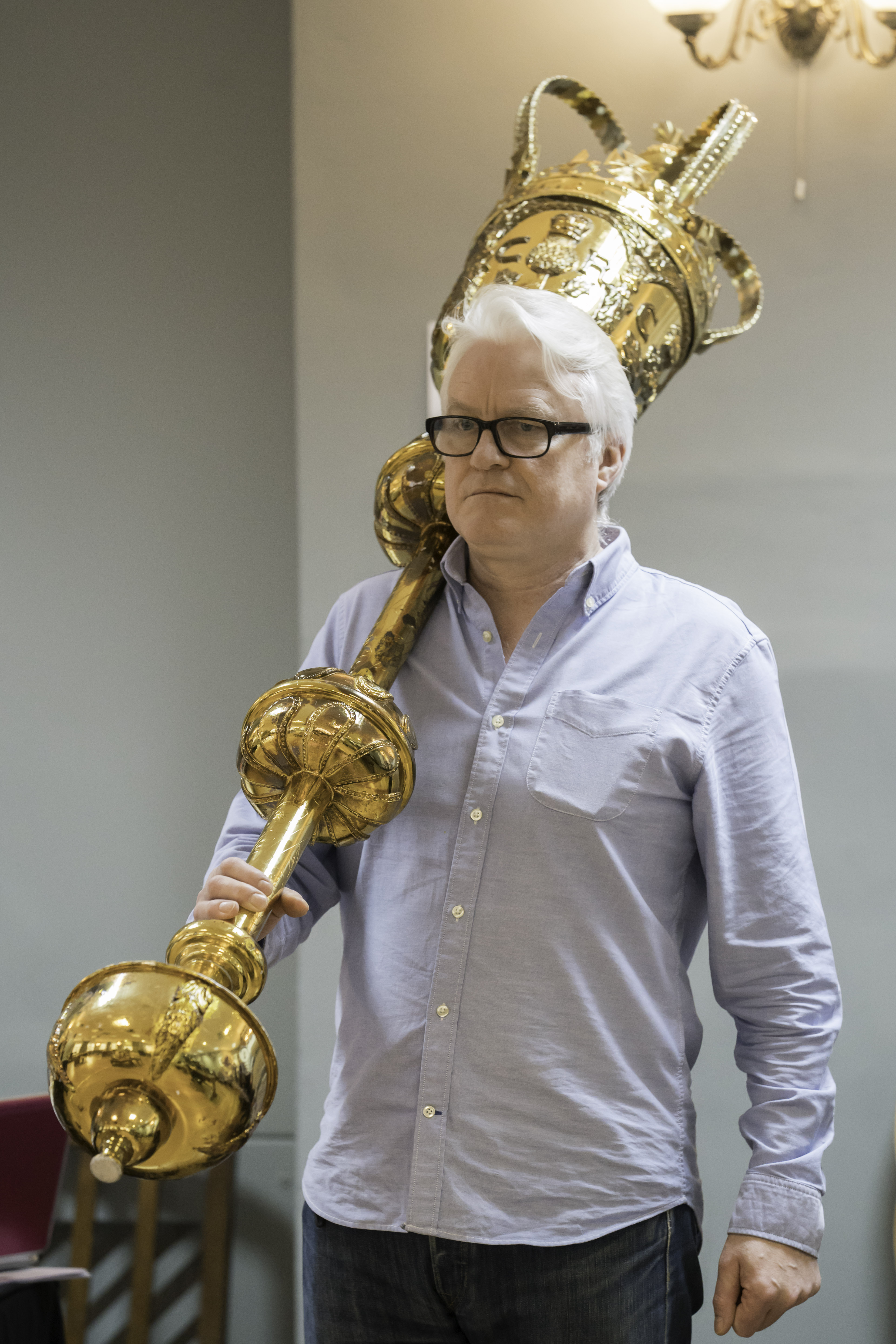 Man holds a gold mace