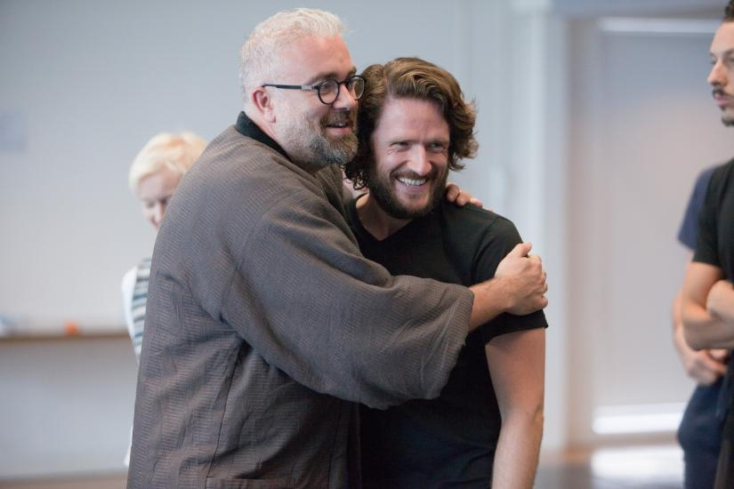 The director hugs an actor