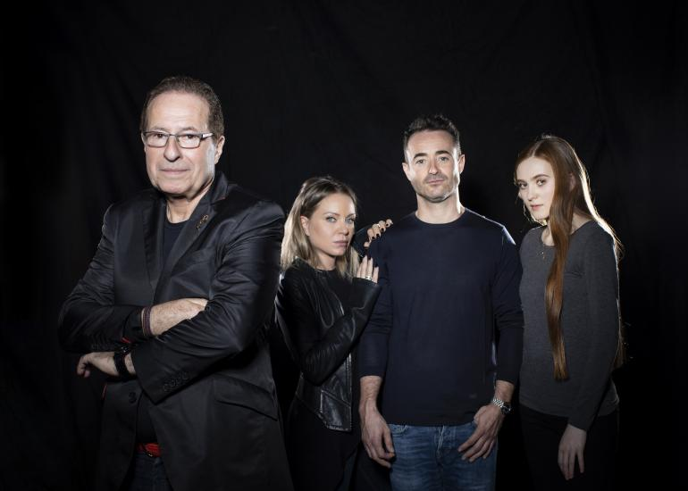 Peter James stands in front of the cast