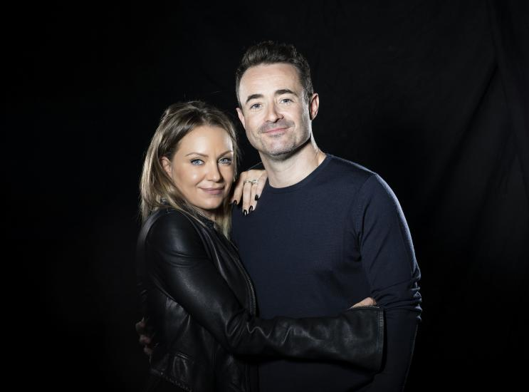 Rita Simons and Joe McFadden stand hugging