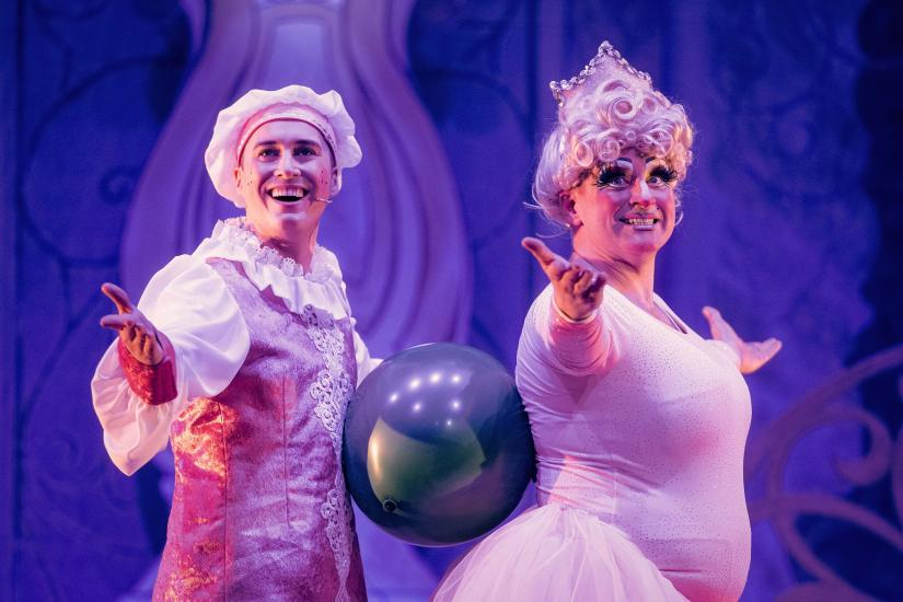 Wishy Washy and Dame Trott wearing ballet costumes, balancing a balloon between their bodies