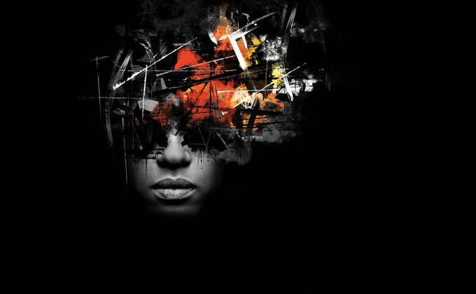 An abstract image - black background with a head image exploding with thoughts