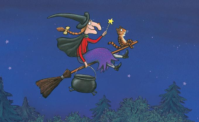 A witch flies on a broom with a cat and a frog