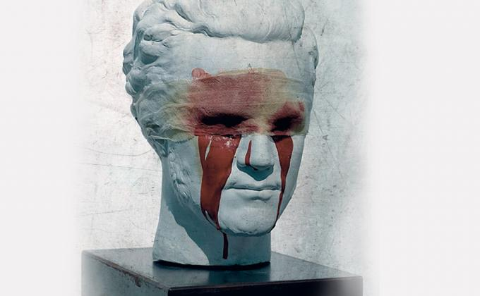 Statue of a Greek man, with bloody bandage covering the eyes