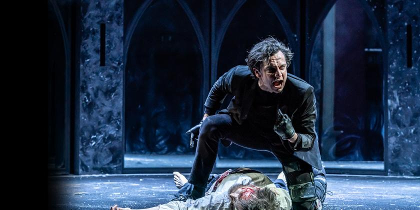 Richard III stands over a man on the floor looking angry