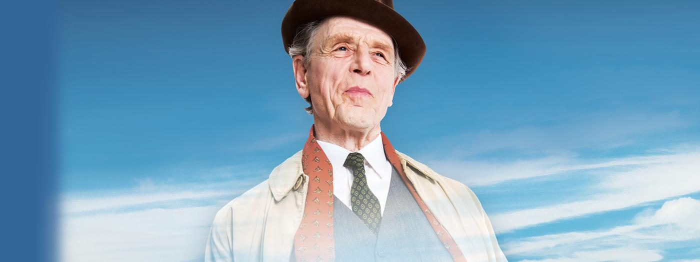 Edward Fox in coat, scarf and hat