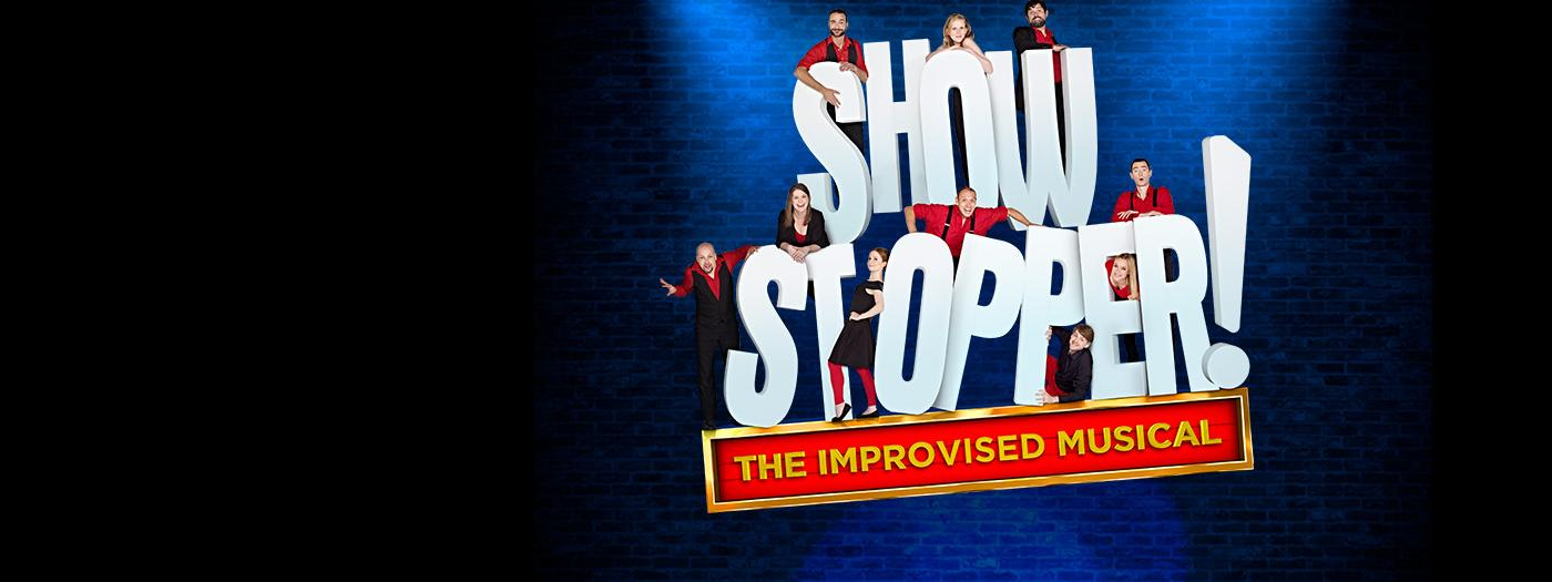Showstopper title with actors in red costumes