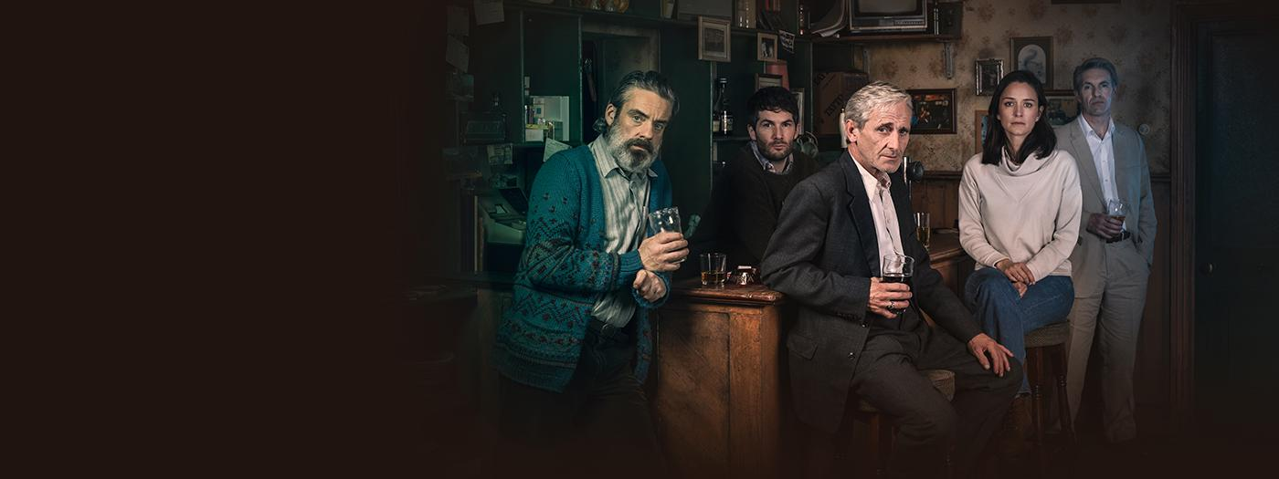The Weir - cast sit round a bar with pints