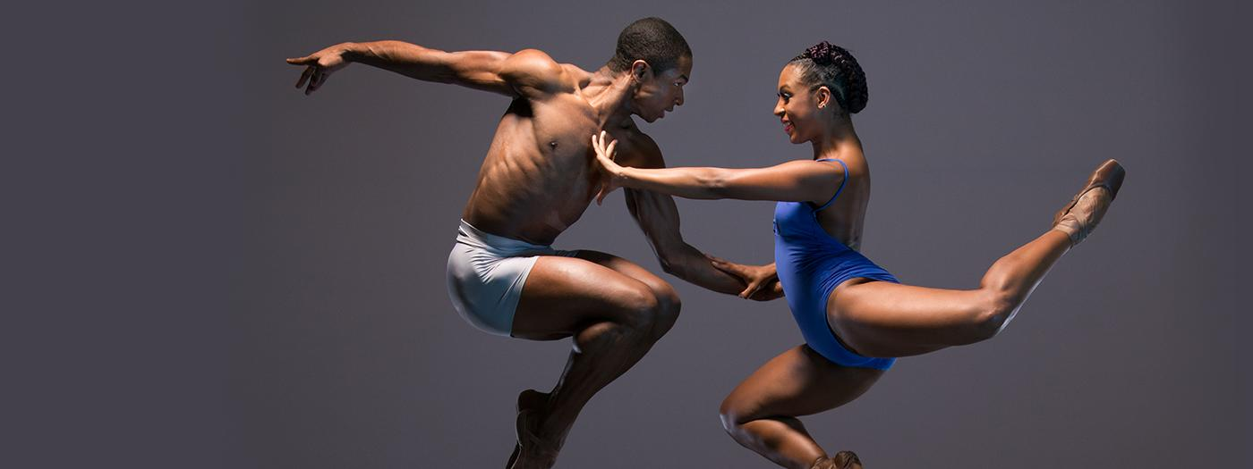 Two dancers appear to levitate in the air mid-dance