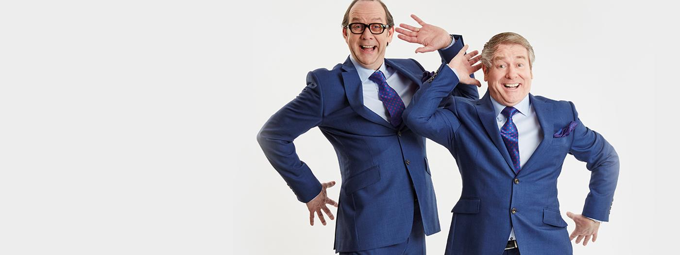 Two men in blue suits mimic Morecambe and Wise's classic Bring me Sunshine dance